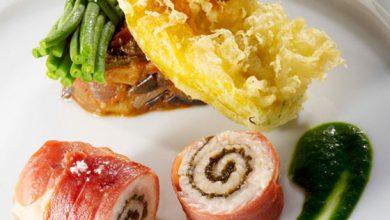 Photo de Queue de Lotte rôtie au jambon noir de Bigorre et tapenade, Ratatouille de légumes du jardin et tempura de fleurs de courgettes